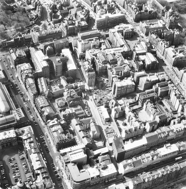 Oblique aerial view showing area surrounding Cowgate, including Chambers Street to left of photograph, George IV Bridge at top, High Street to right, and South Bridge to bottom