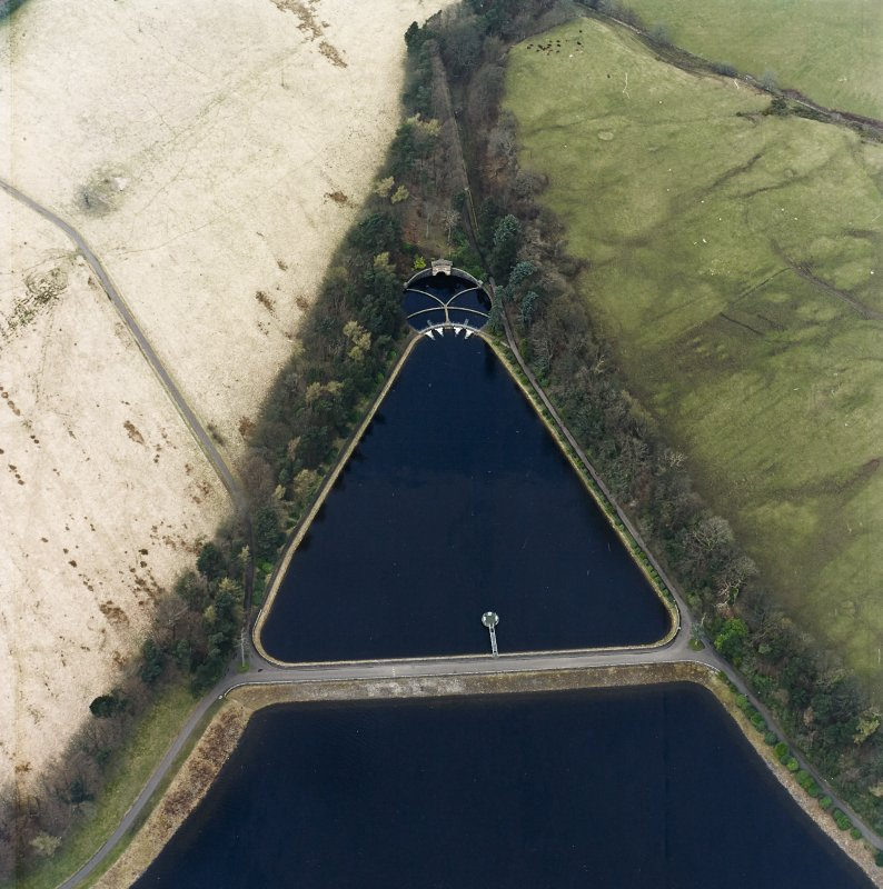 Oblique aerial view of the gauge basin and measuring pond of Craigmaddie (NS57NE 61) Reservoir