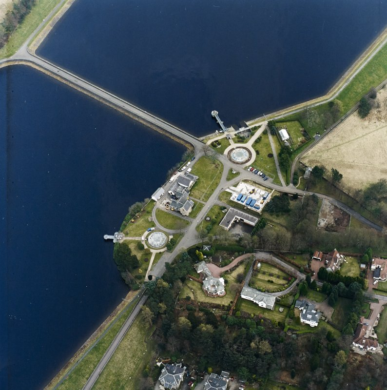 Oblique aerial view of Mugdock (NS57NE.63) and Craigmaddie (NS57NE.61) Reservoirs including Mugdock Straining Well (NS57NE 63.05) and Chlorinating House  (NS57NE 63.04)