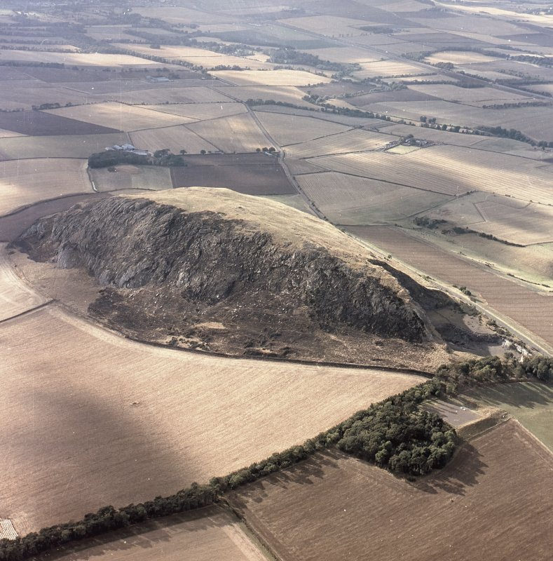 Oblique aerial view centred on the remains of the fort showing recent fire damage, taken from the SE.