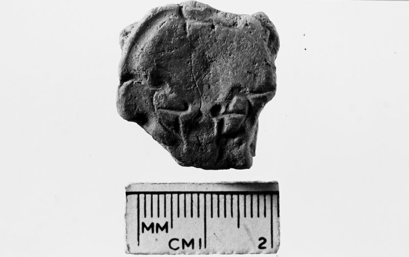House 5. Small Find 280. Fragment of clay mould.