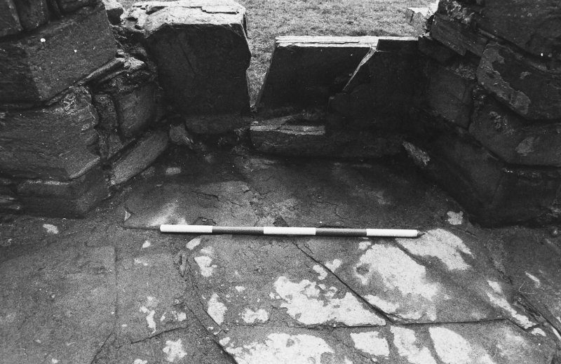 Excavation photograph : west range - room 2 - window splay, from west.