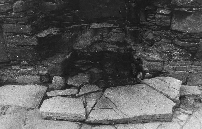 Excavation photograph : west range - room 1 fireplace excavated, from east.