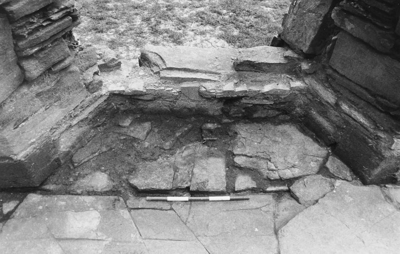 Excavation photograph : west range - room 1 window excavated, from west.