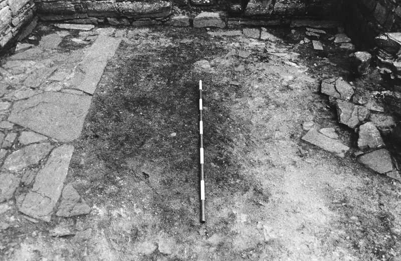 Excavation photograph : east range - room 3 floor from west.
