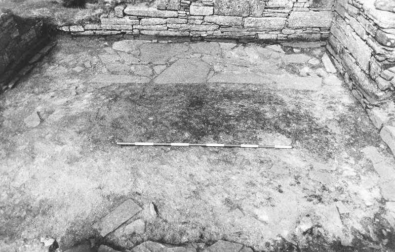 Excavation photograph : east range - room 3 floor from south.