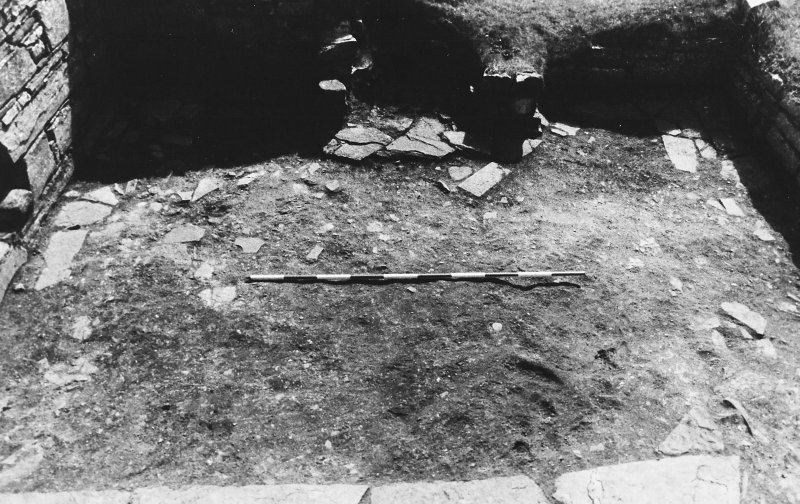 Excavation photograph : east range - room 3 floor from north.