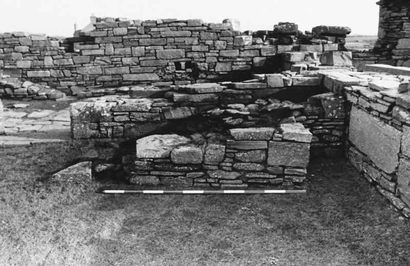 Excavation photograph : east range - feature outside room 4, from west.