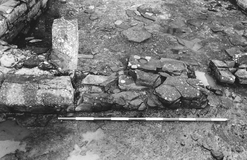 Excavation photograph : east range - room 2 fireplace partition from east.