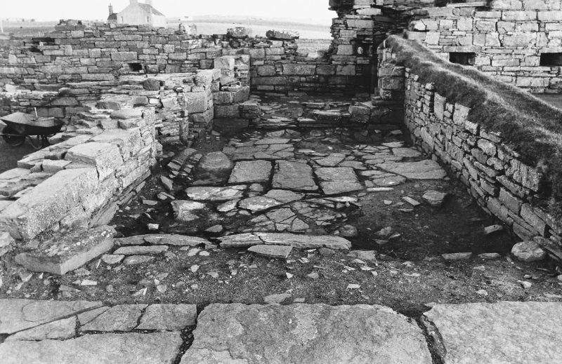 Excavation photograph : south range - room 3 paved floor, from west.
