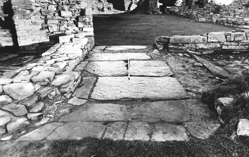 Excavation photograph : south range - south entrance paving, from south.