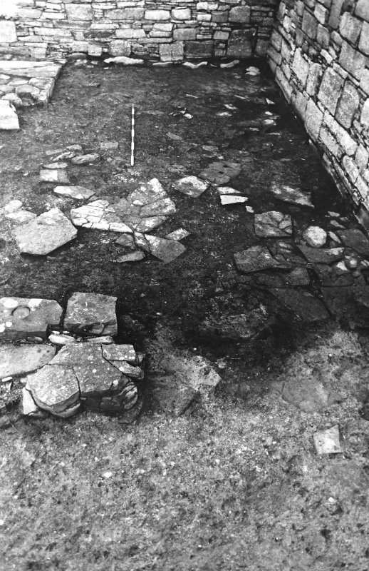 Excavation photograph : east range - room 2 floor, from south.
