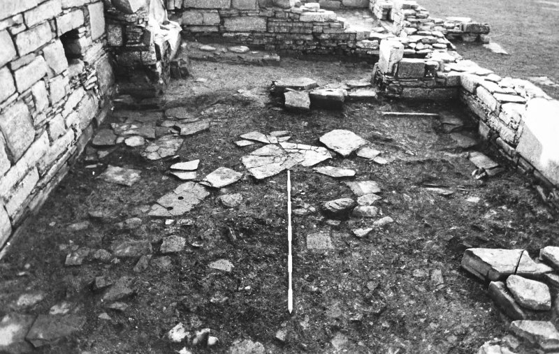Excavation photograph : east range - room 2 floor, from north.