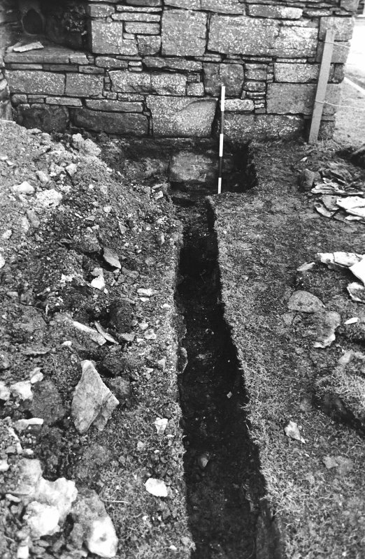 Excavation photograph : outside palace, trench after removal of paving, from north.