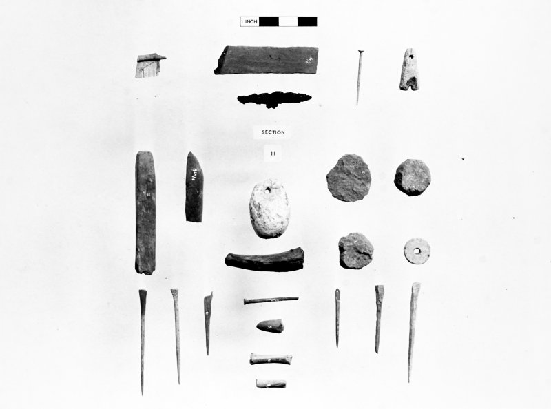 Finds Photograph: Small finds from section III, including pins, weights, bone and stone implements and comb fragment.