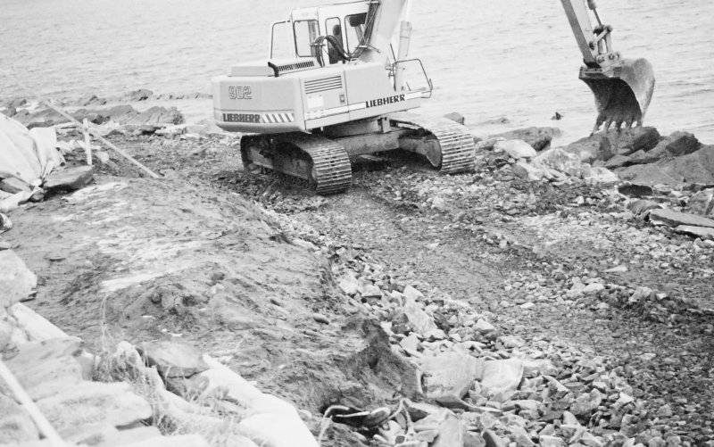 Construction Photograph: Coastal restorative work to build a breakwater for the future protection of Jarlshof. Armoury around sea side of beach access road W-E.
