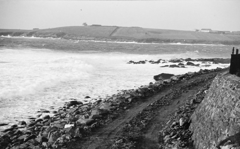 Construction Photograph: Coastal restorative work to build a breakwater for the future protection of Jarlshof. Access road on beach E-W.