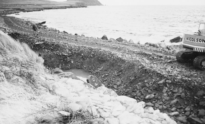 Construction Photograph: Coastal restorative work to build a breakwater for the future protection of Jarlshof. Trench for foundations W-E.