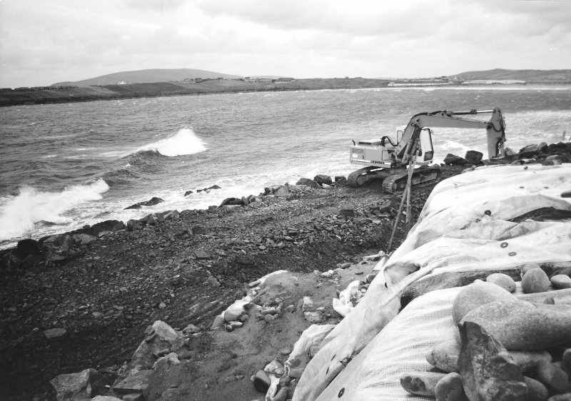 Construction Photograph: Construction of breakwater.