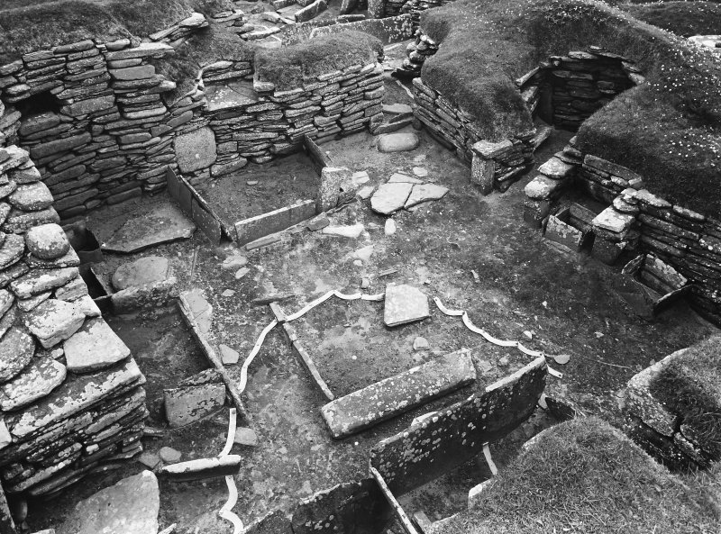 House 5; interior from above.  Archaeological features marked on ground in tape.