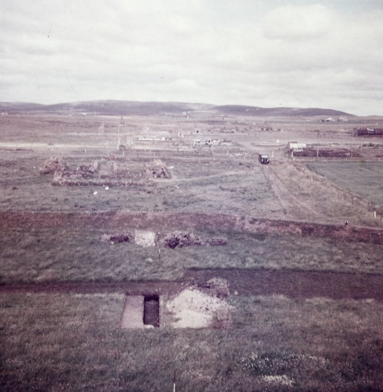 Excavation photograph: View of excavations from cairn mound.