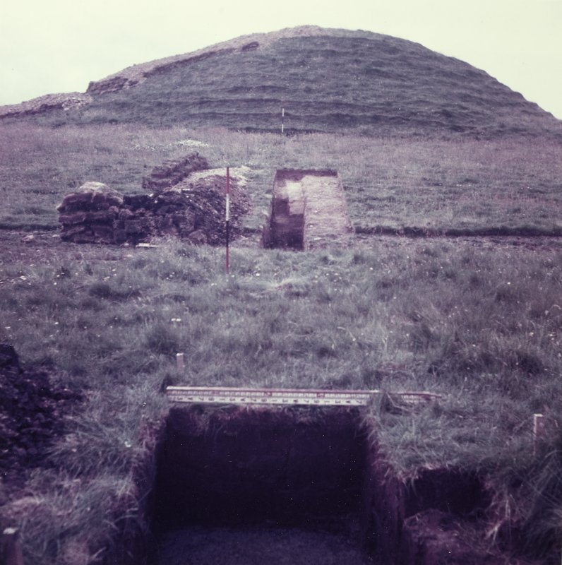 Excavation photograph: Trenches on north east side of cairn.