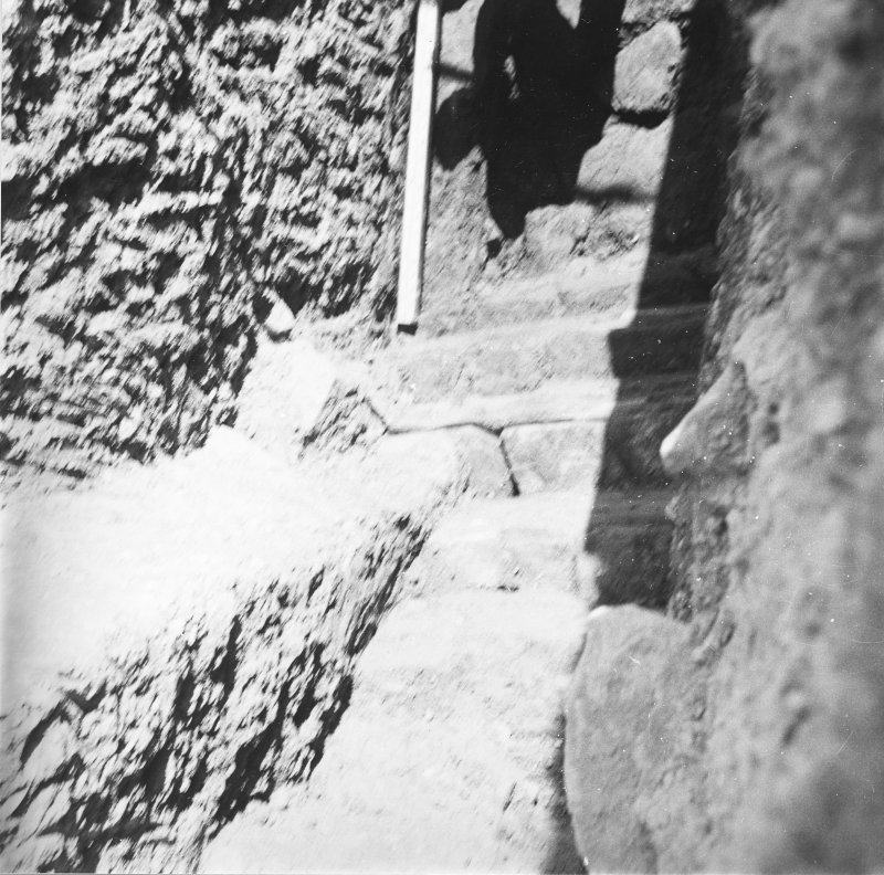 Excavation photograph: Containing wall that surrounds south east side of chamber.