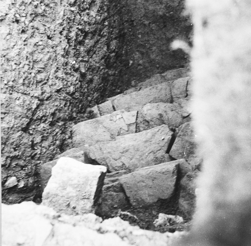Excavation photograph: Containing wall that surrounds north east side of chamber.