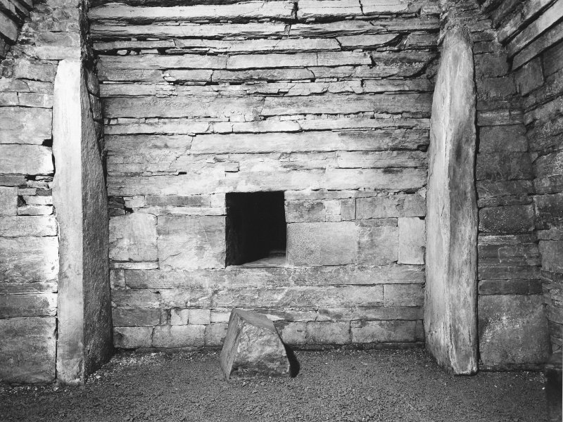 Interior of cairn; view of wall and cell.