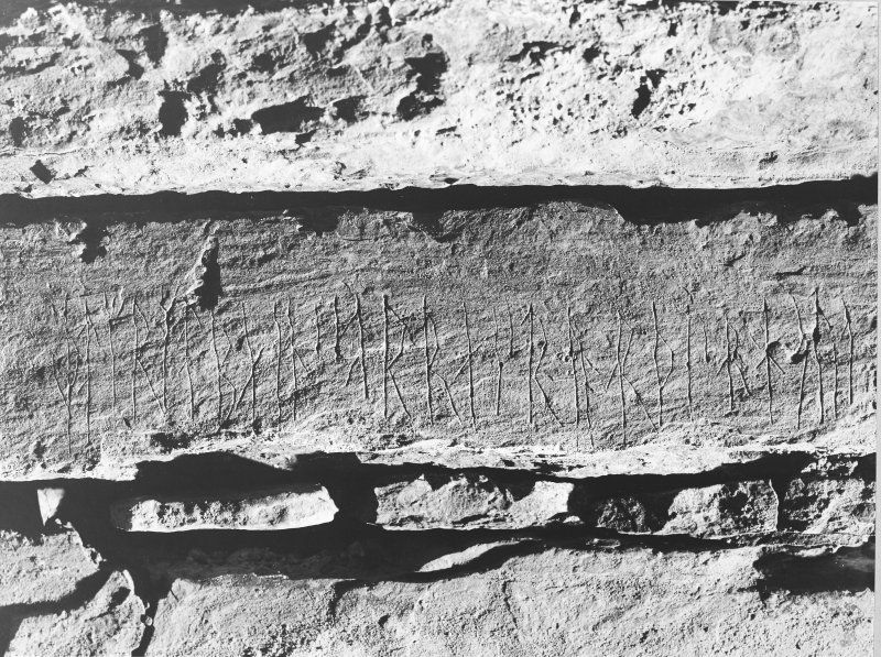 Interior of cairn; runes - on west wall above entrance.