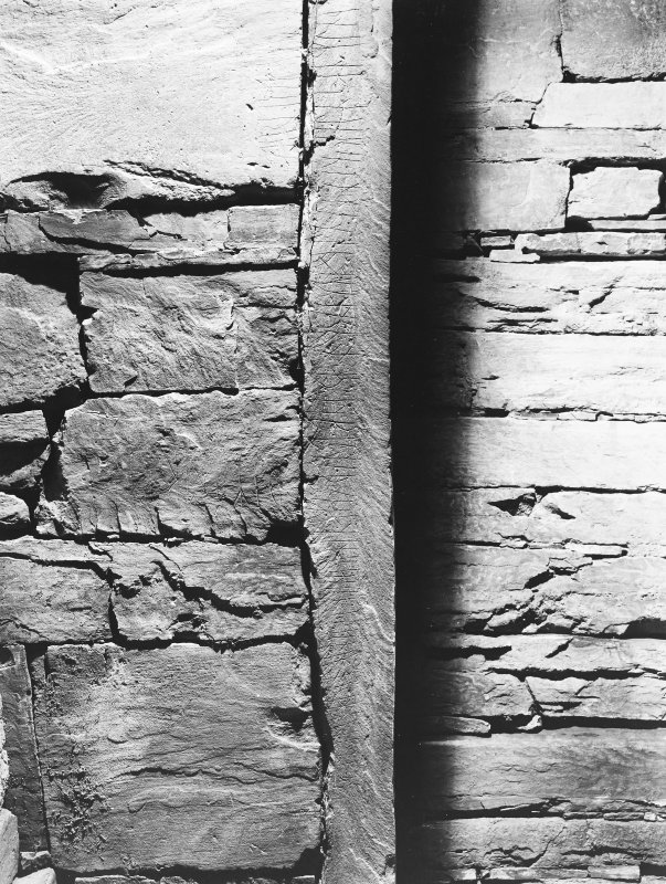 Interior of cairn; runes - on edge of grest slab of north-west buttress.