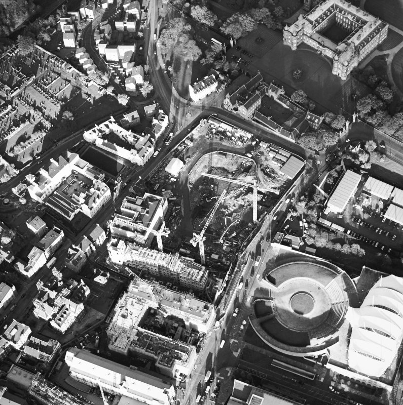 Oblique aerial view showing the Scottish Parliament under construction and Queensberry House adjacent.