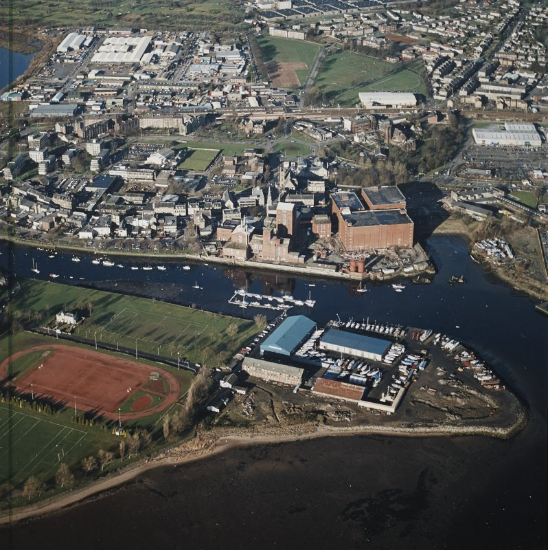 Oblique aerial view showing the boat yard and whisky distillery, Dumbarton