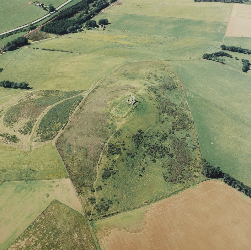 Oblique aerial showing tower house at Dunnideer, Aberdeenshire