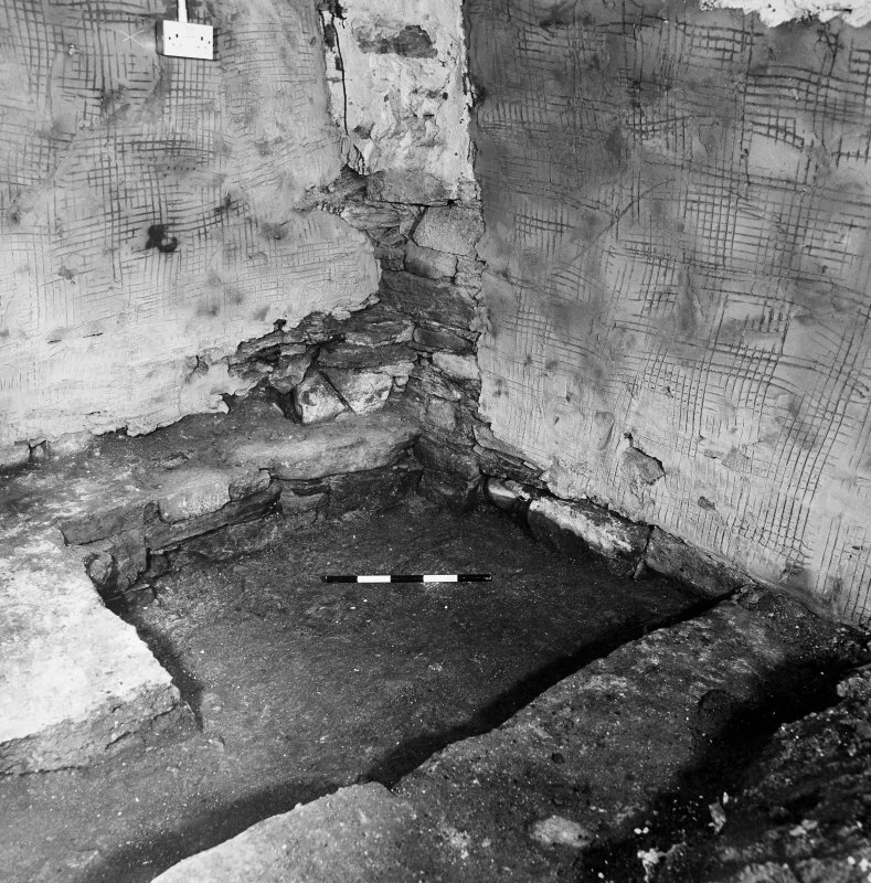 Excavation photograph. Room 2: detail of NE corner, oblique from SW.