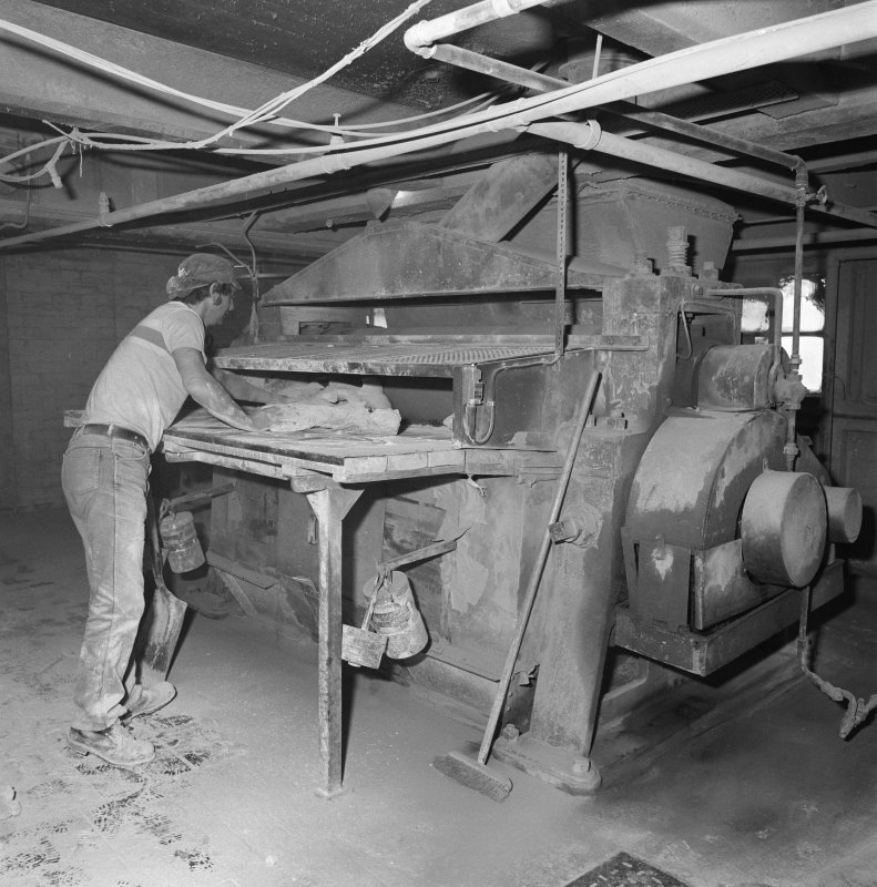 Kirkcaldy. Nairn's Linoleum works. View showing the loading of oxidised 'cement' slabs into the mixing machines