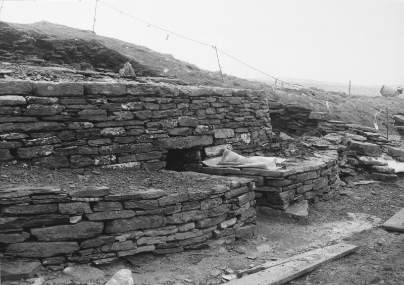 Front of tomb as partly reconstructed showing rebuilt walls