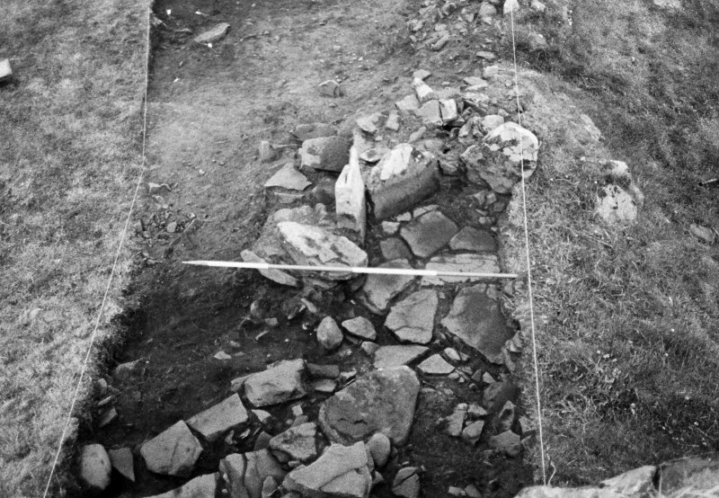 Trench 1,area A, coursed masonry abutting broch wall,after cleaning from south