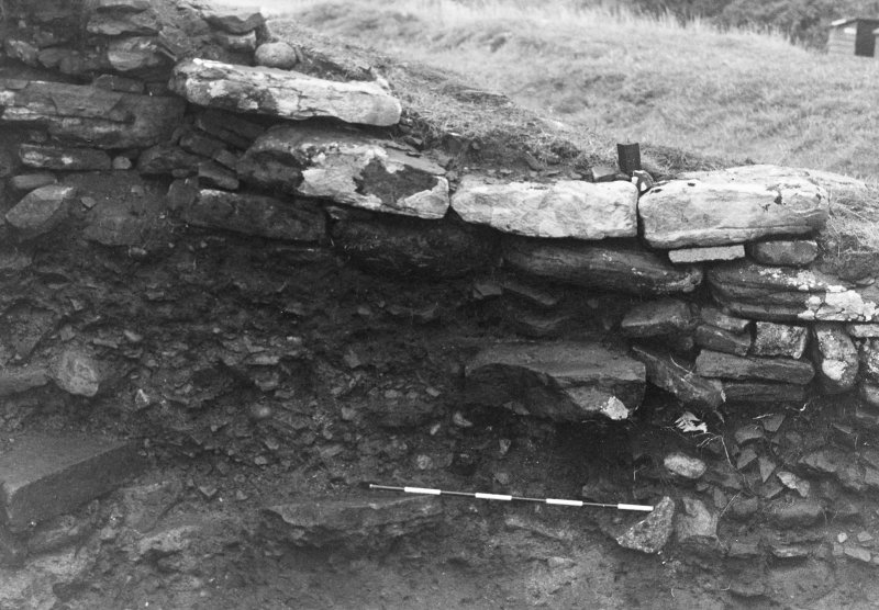 Trench 1, Area B. West wall of outbuilding (South end).  From East.