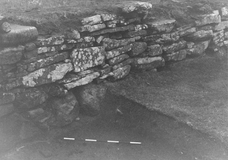 Trench 1, Area B. North wall of outbuilding.  From South-West.