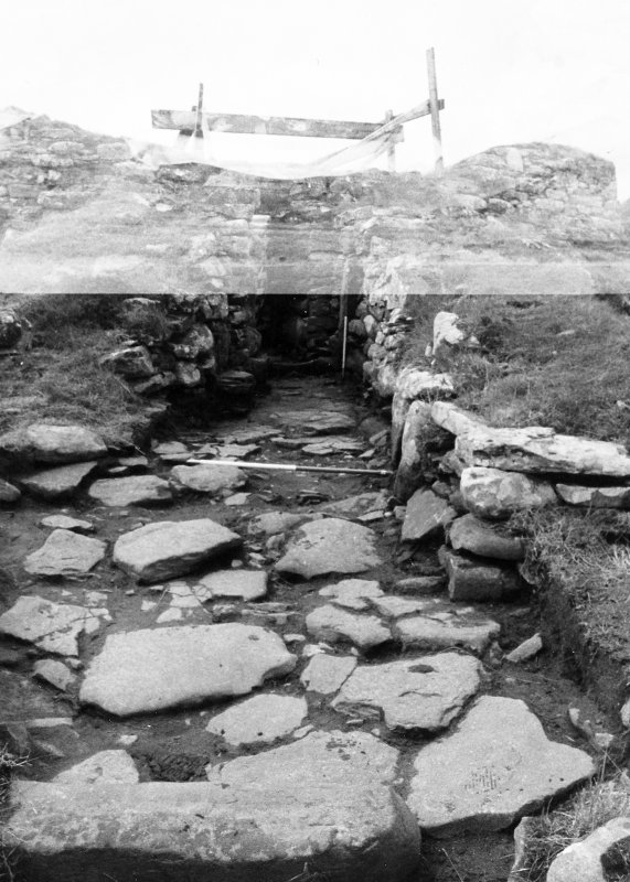 Entrance passage, after cleaning, showing paving.  From North-East.