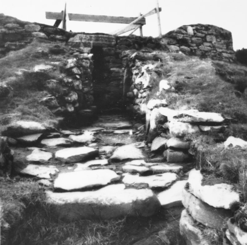 "Excavation photograph -  Entrance passage, after clearing, looking towards broch entrance through ""forework"", from E-NE. Photographic copy of polaroid print. Copied 1995."