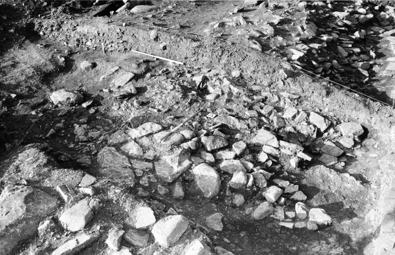 Excavation photograph : 006, lower stones after machine trample removed.