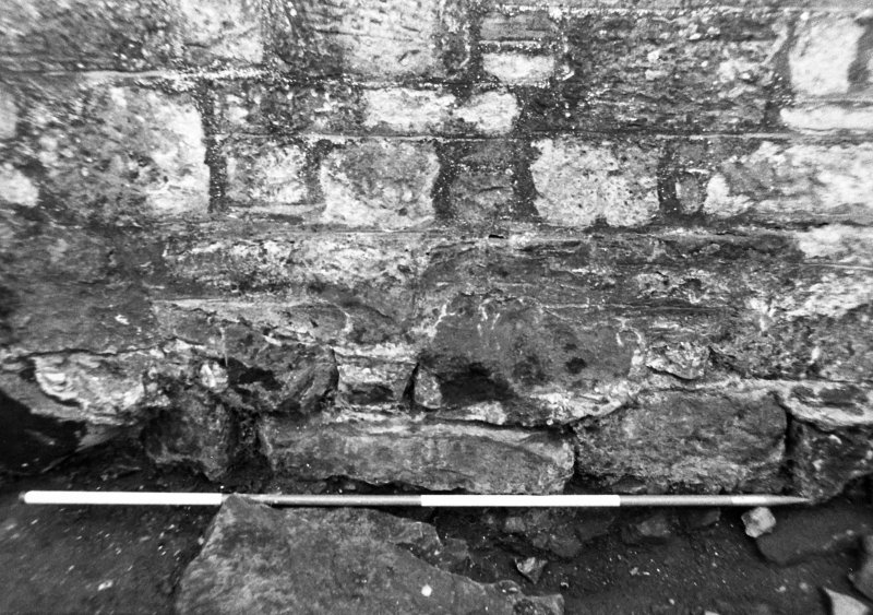 Excavation photograph : disturbance along base of wall f108, from N.