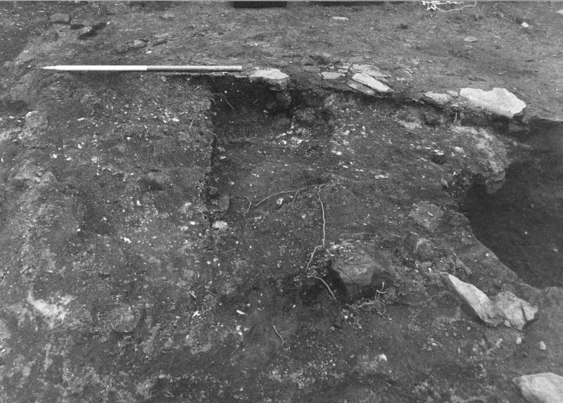 Excavation photograph : orange burnt material and stoney deposit f260, below f148, from N.