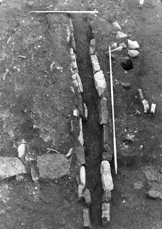 Excavation photograph : detail of drain f205, from S.