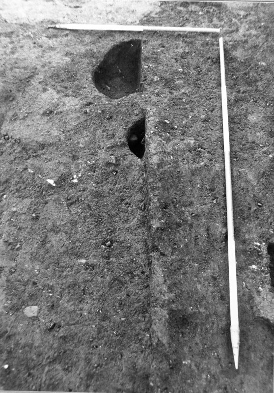 Excavation photograph : section across slot f468, from W.