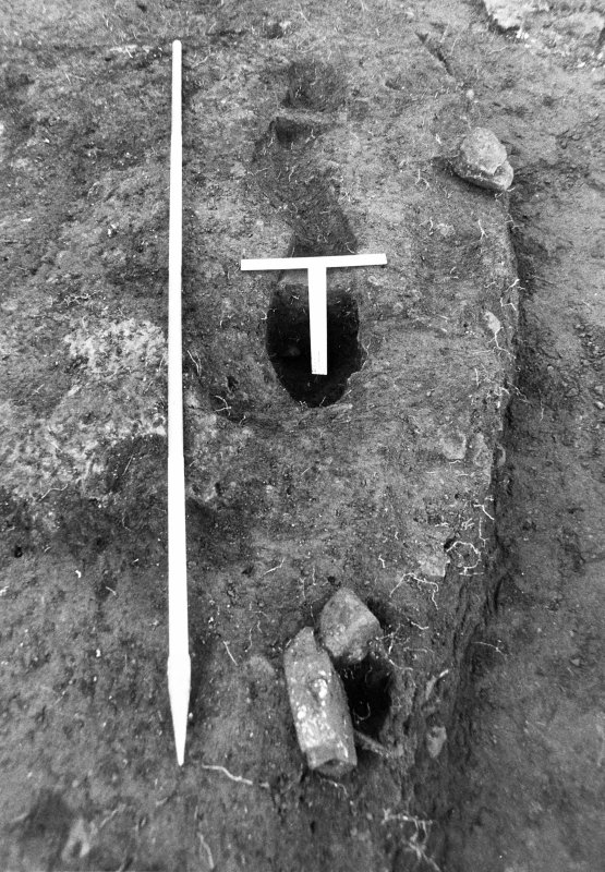 Excavation photograph : beam slot f575 with sections, from E.