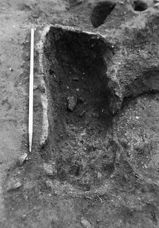 Excavation photograph : charcoal rich fill in trough f590, from W.