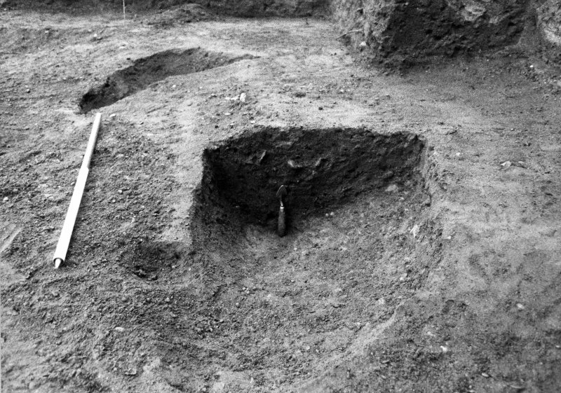 Excavation photograph : section across feature f702, from W.